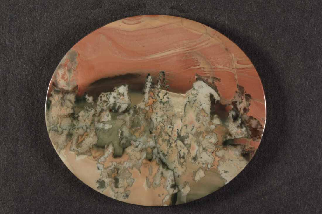 Oval Morrisonite cab with peach sky