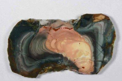 Morrisonite slab with pink tornado in dark blue sky