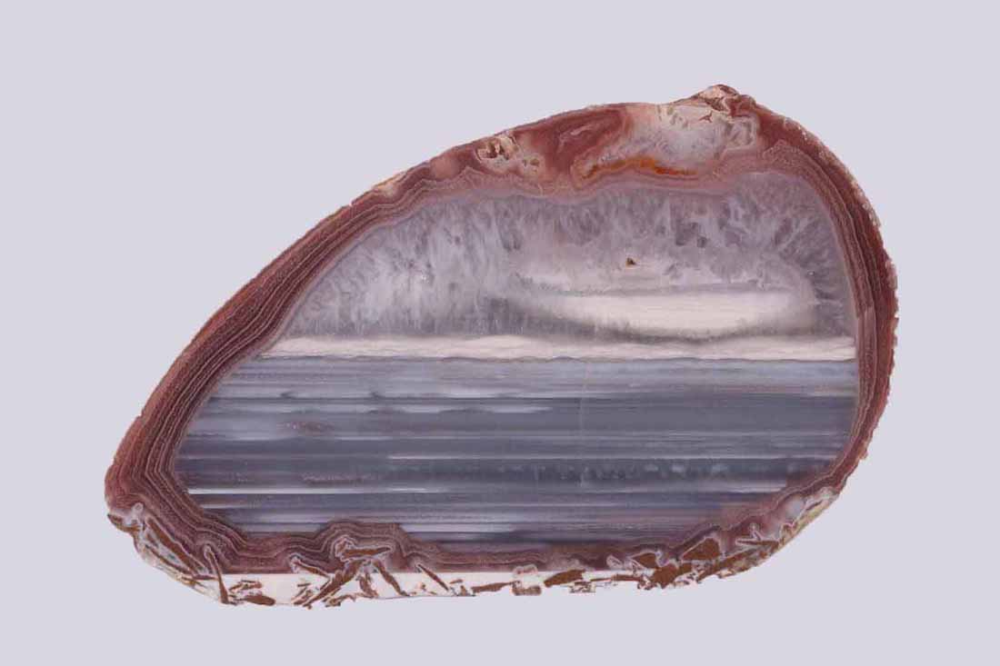 "a 3 1/4"" solid agate with Uruguay banding"